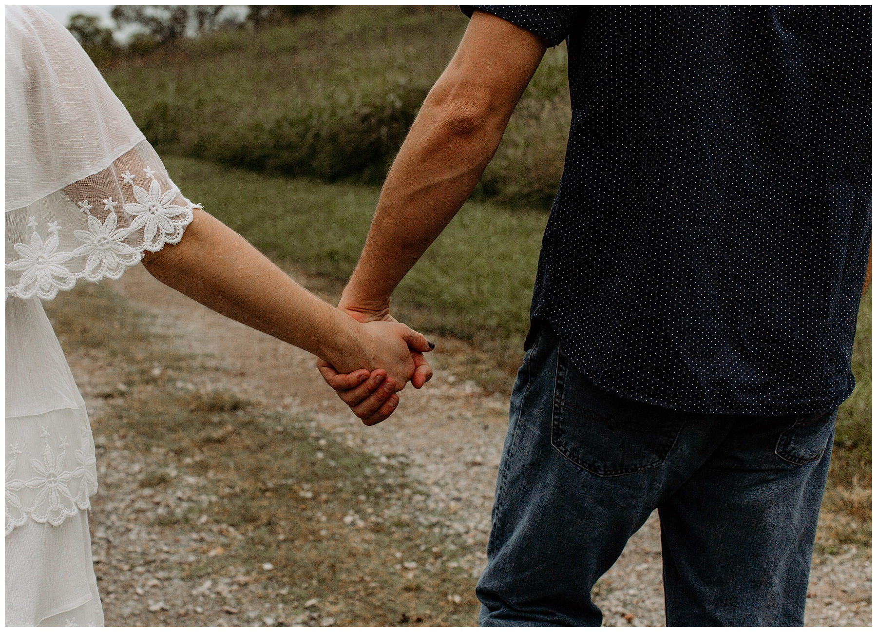 couple holding hands in tennessee forest